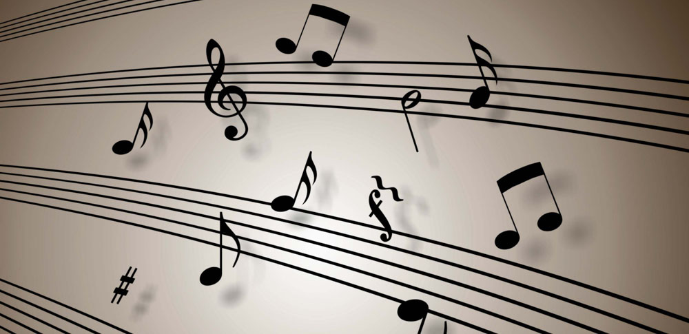 Lots of musical notes scattered all over a music sheet to reflect why soothing music is great for a sensual massage