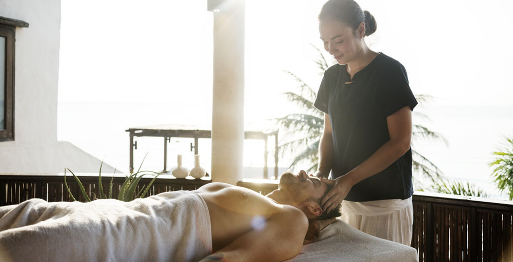 A male client getting an Asian body to body massage