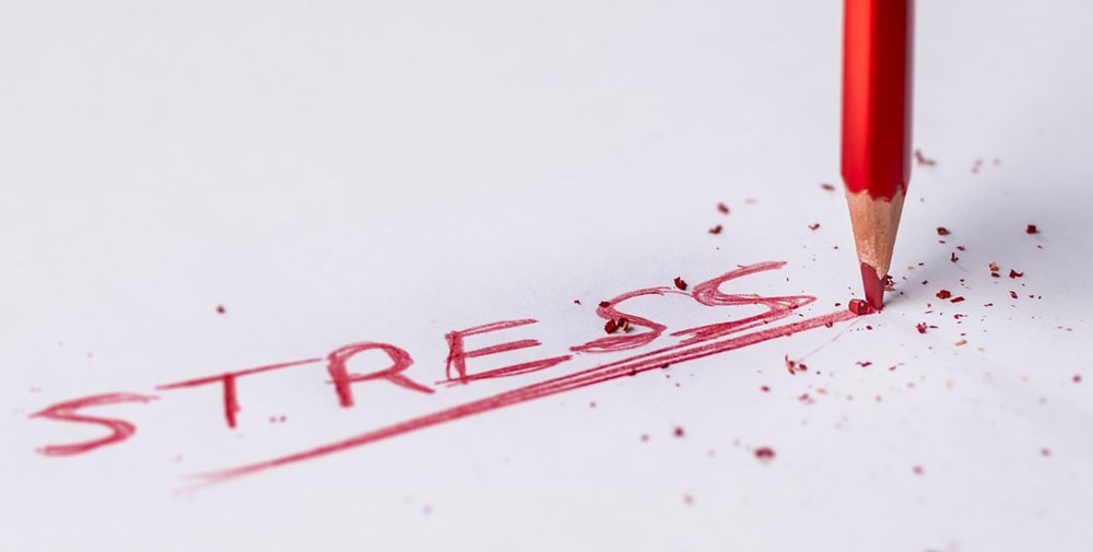 The word stress handwritten on a piece of paper