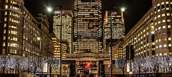 Lots of buildings lit up at night and close to where you can get an Asian massage with the escort girl of your choice at the London Marriott Hotel West India Quay